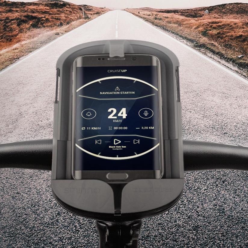 Ein Smartphone ist in einem Cesacruise befestigt und hat das App-Design von CruiseUp aufgerufen. Montiert ist es an einen Fahrradlenker
